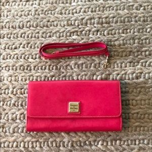 Pink Dooney & Burke clutch with detachable strap